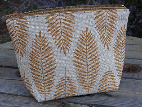 Trousse de toilette – feuilles moutarde sur fond couleur lin